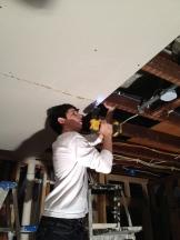 Dusty installing dry wall