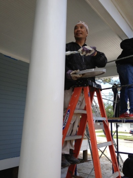 Mr. Campos putting on a final coat of paint
