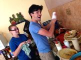 Rachel and Mr. Mulaney washing dishes