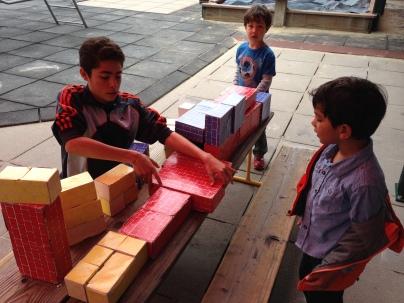 Julien plays with pre-schoolers as Phoebe Hearst Preschool