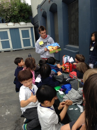 Lachlan reads to students at Rosa Parks Elementary School