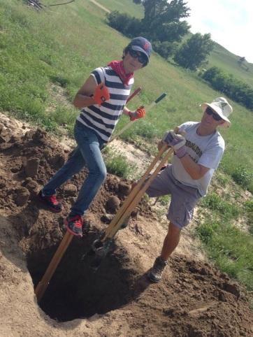 Allie and Matt digging a six foot hole