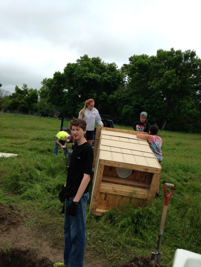 William, Liz, Hannah, and Stephanie getting ready to install another outhouse