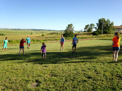 Playing kickball with local children.