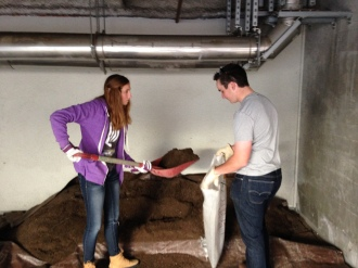 Daniel and Kat at work with dirt for the garden