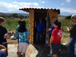 Arturo explains the compostable outhouse.