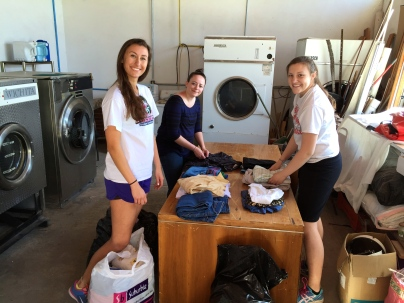 Maris, Alexis, and Teresa in the laundry