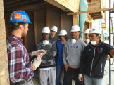 Receiving instructions on how to caulk.