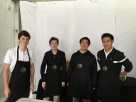 Jack, Dylan, Andrew, and Jack prepare to serve food for the day.