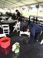 Jake and GianCarlo cleaning off the tables and chairs.