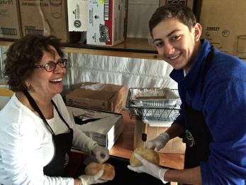 Annie and Robbie cheerfully preparing food.