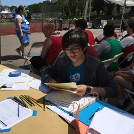 Damian helping to get the athletes to their events . . .