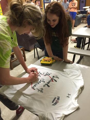 Olenka preparing our shirt.