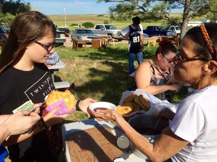 Caroline buying fried Lakota bread.