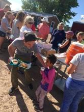 Matt helps out a young Lakota