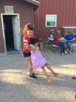 Maya playing with child