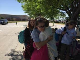 Caroline and Olenka hug goodbye