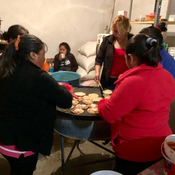 The women cooking for those attending the rosary